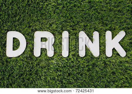 Drink Text Made Of White Wood Vector Design Element On Grass Background.