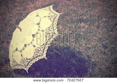 Lacy Parasol On The Grass. Tinted Vintage