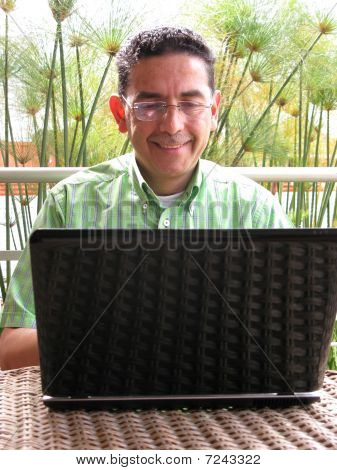 Business Man Working On Laptop With Glasses And Smiling