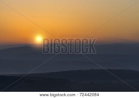 Sun Rising Above The Mountains In The Mist