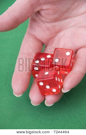 Close Up Of A Hand Throwing Dices