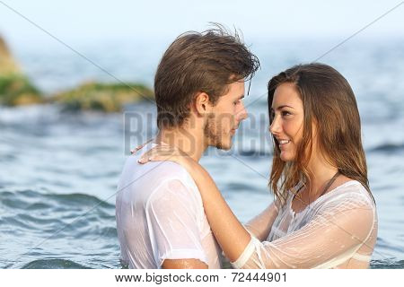 Young Couple In Love Bathing In The Sea