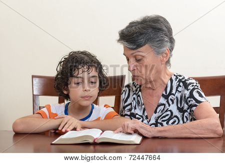 Hispanic Family Studying The Holy Bible