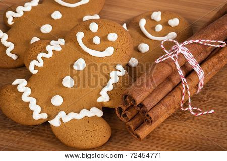 Freshly Baked Gingerbread Man Cookies And Cinnamon Sticks