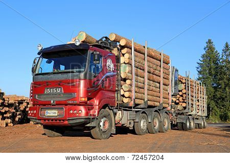 Red Sisu 18E630 Timber Truck Ready To Unload Logs