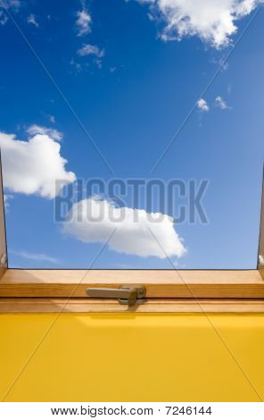 Roof Window And Bue Sky With White Clouds