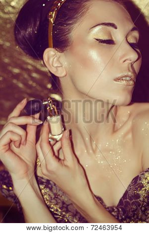 Portrait Of Young Woman With Gold Makeup