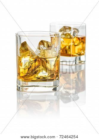 Two glasses of whiskey on a white background