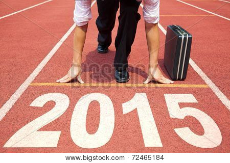 Happy New Year 2015. Businessman Preparing For Running