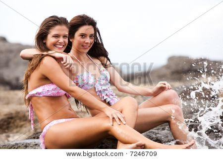 Two Friends In Bikinis At The Beach