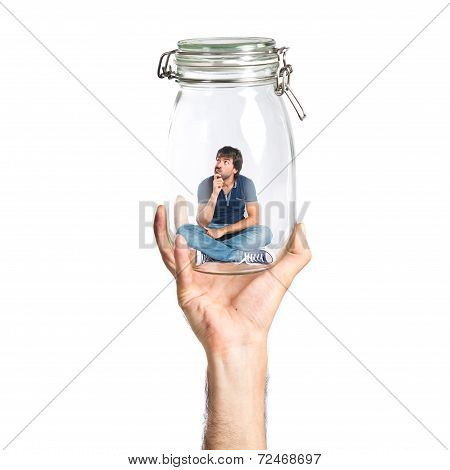 Man Thinking Inside Jar Glass