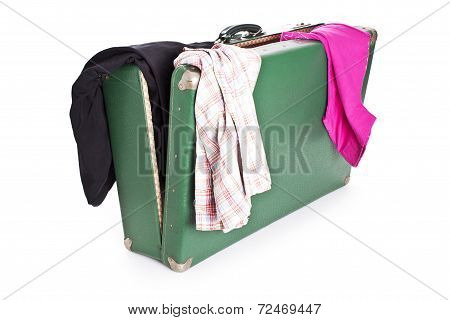 Clothes on old suitcase isolated on white