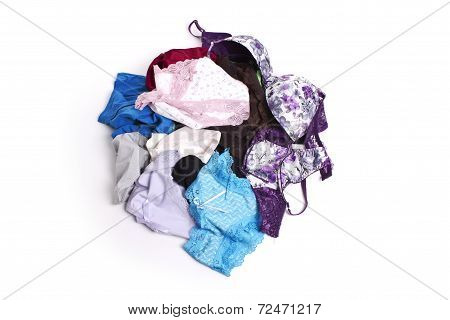 Lots of messy colorful clothes isolated on white background.