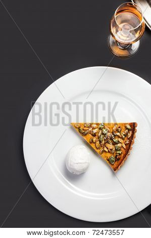 Fresh Pumpkin Pie With Whipped Cream And Pumpkin Seeds On White Plate Over Black Chalk Board. Beauti