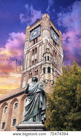 Sculpture Of Nicolaus Copernicus In Front Of The Town Hall In Torun At Sunset, Poland.