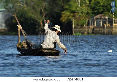 Fisherman In The Mekong Delta, Vietnam