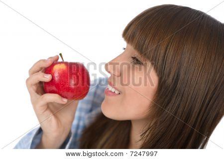 Happy Teenager Eating Healthy Apple For Breakfast