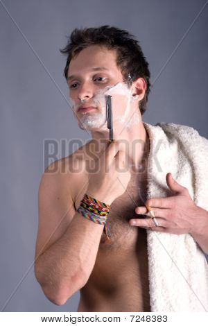 young man shaving antique cutthroat