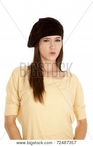 Woman Yellow Shirt Black Hat Serious Look