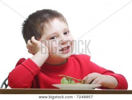 Cute Boy In Red Eating Grapes