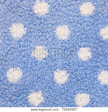Close Up Of Blue Carpet With White Polka Dots