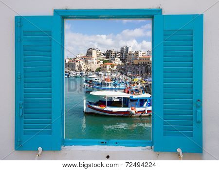 window with old port of Heraklion, Crete, Greece
