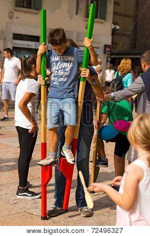 Boy On Wooden Stilts