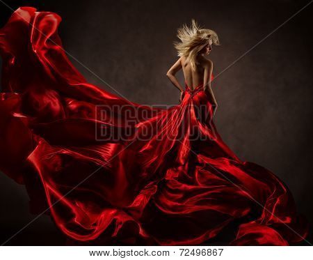 Woman In Red Waving Dress With Flying Fabric. Back Side View