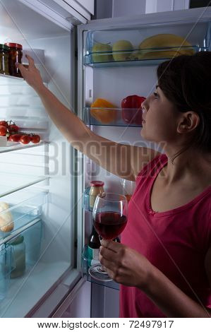 Hungry Woman Holding Glass Of Wine