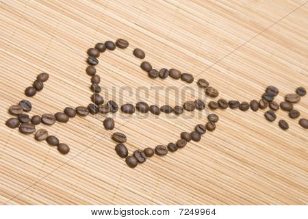 Coffee heart pierced by an arrow
