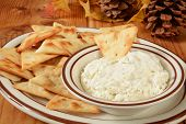 stock photo of pita  - A plate of toasted pita bread crackers with a cream cheese dip - JPG
