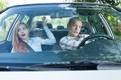 image of dangerous situation  - Couple during dangerous situation in a car - JPG