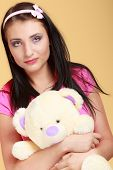 pic of child missing  - Portrait of childish young woman with headband holding toy - JPG