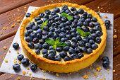 image of tarts  - Blueberry Tart on vintage brown wooden background - JPG