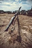stock photo of mg  - Old vintage machine gun standing on tripod - JPG