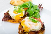 stock photo of benediction  - Eggs benedict with bacon and spinach on white plate