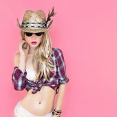 foto of redneck  - party in cowboy style sexy girl on pink background - JPG