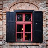 image of jalousie  - Retro window with black jalousie outdoor and old brich wall - JPG