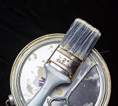 stock photo of bristle brush  - A top down view of a paint brush laying on top of a paint can - JPG