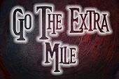 pic of mile  - Go The Extra Mile Concept text on background - JPG