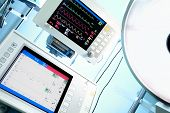 stock photo of icu  - Medical Monitor and surgical lamp in ICU - JPG