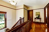 picture of upstairs  - Upstairs hallway with hardwood floor and staircase View of balustrade - JPG