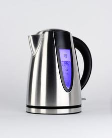 stock photo of boiling water  - Steel electric kettle with boiling water with black plastic inserts and blue backlight on a white background - JPG