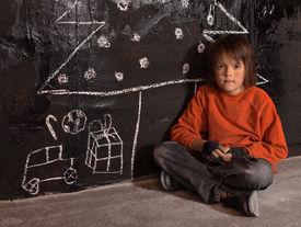 foto of sad christmas  - Poor kid at Christmas time on the street  - JPG