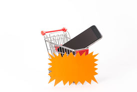 stock photo of caddy  - Caddy for shopping with smartphone on white background - JPG