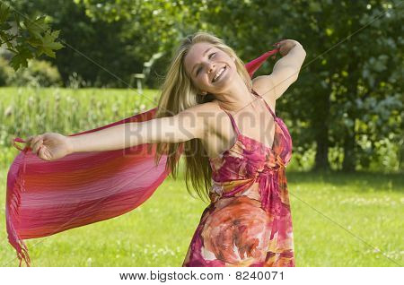 Young woman enjoys nature