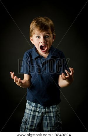 Young Boy Screaming With Emotion