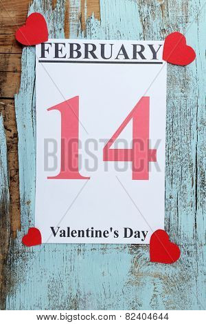 Valentines Day, February 14 on calendar on wooden background