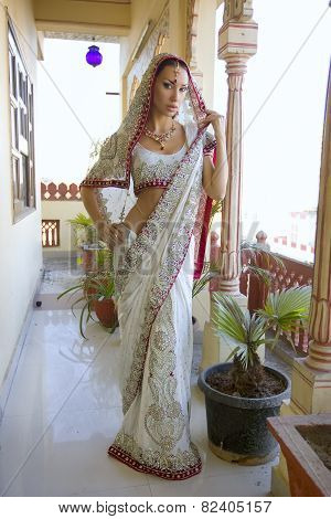 Beautiful Young Indian Woman In Traditional Clothing With Bridal Makeup And Oriental Jewelry