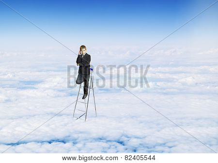 A Boy With A Telephone In A Suit On The Stairs In The Sky